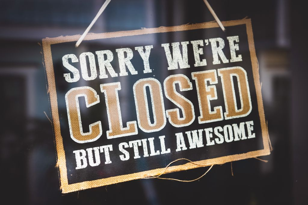 Door sign that says sorry we're closed but still awesome